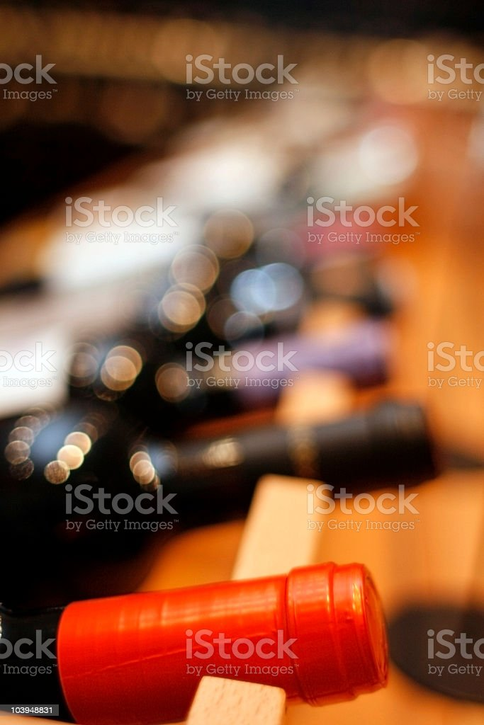 Neck of Wine Bottle in Rack - Close-Up royalty-free stock photo