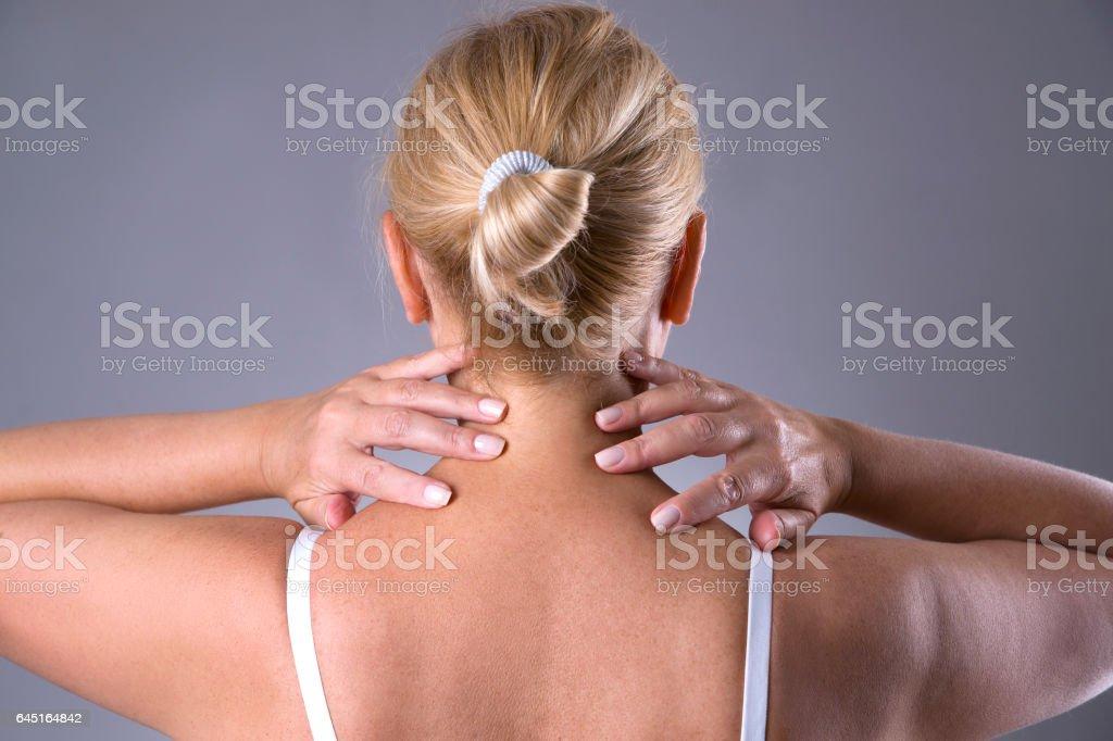 Neck pain, massage of female body, neckache in woman\'s body on gray...