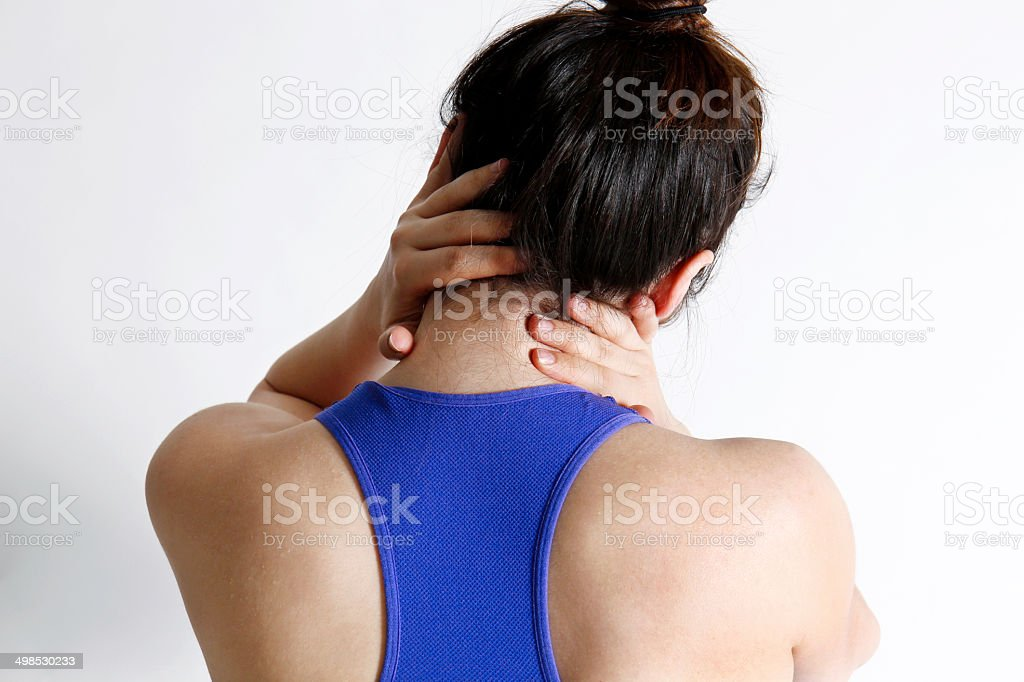 Young woman holding neck.