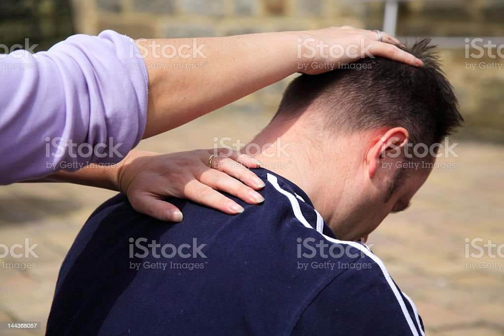 Neck stretch as part of a traditional Thai Body Massage royalty-free stock photo