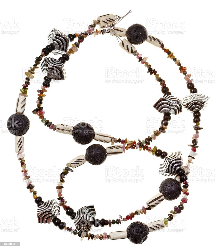 necklace from lava, carved bone, stones, metal royalty-free stock photo