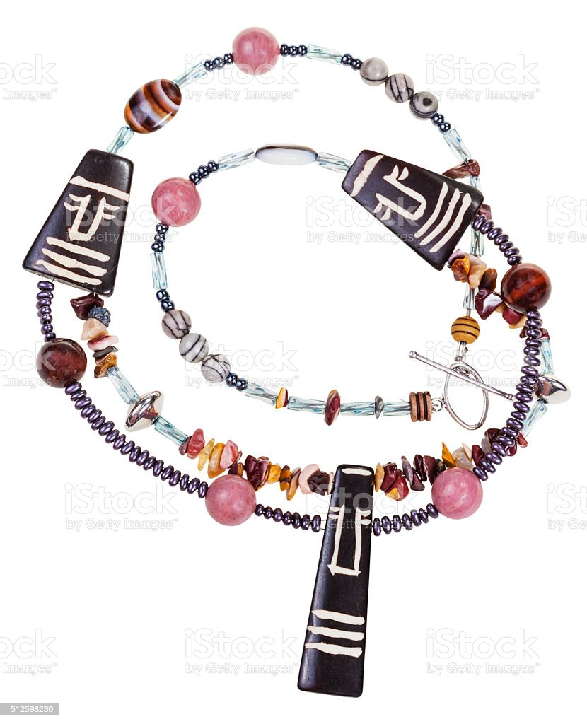 necklace from natural gemstones and carved figures stock photo