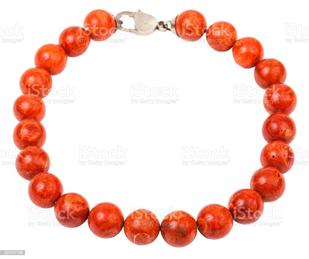 necklace from red coral beads isolated on white stock photo