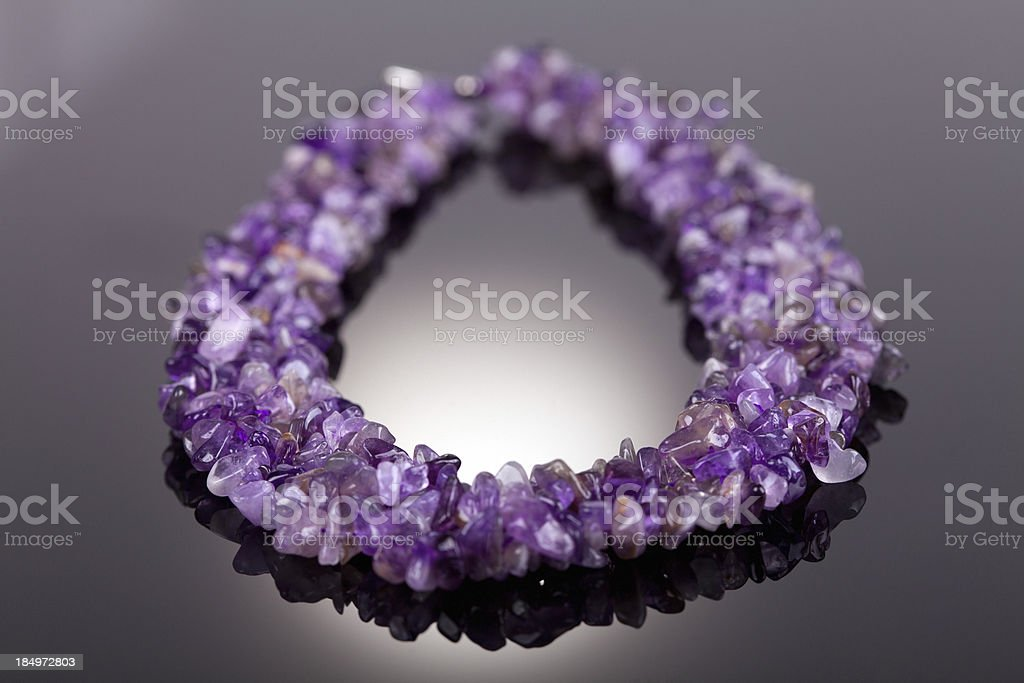Necklace made of amethyste on dark background royalty-free stock photo