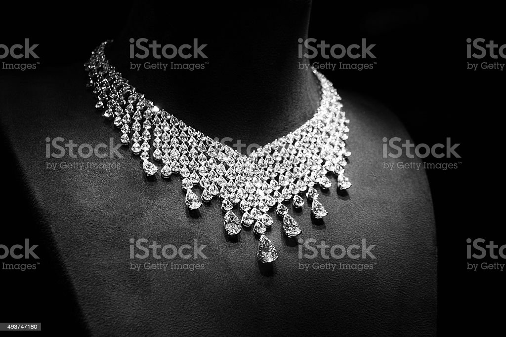Necklace made of white gold with diamonds on a stand. stock photo