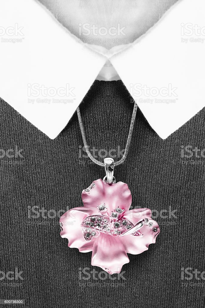 Necklace on pullover stock photo