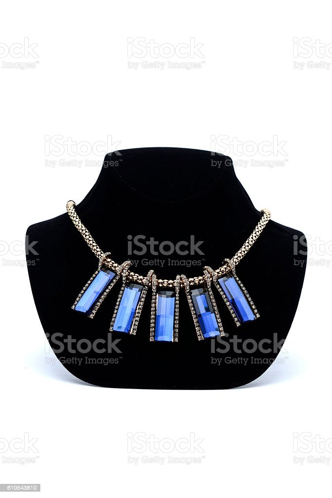 Necklace with blue gems on a mannequin stock photo