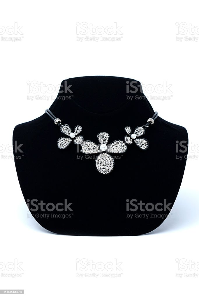 Necklace with flowers on mannequin isolated on white stock photo