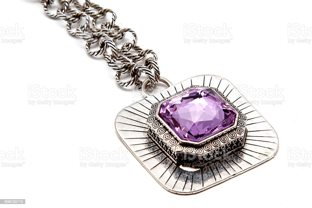 Necklace with large purple stone stock photo