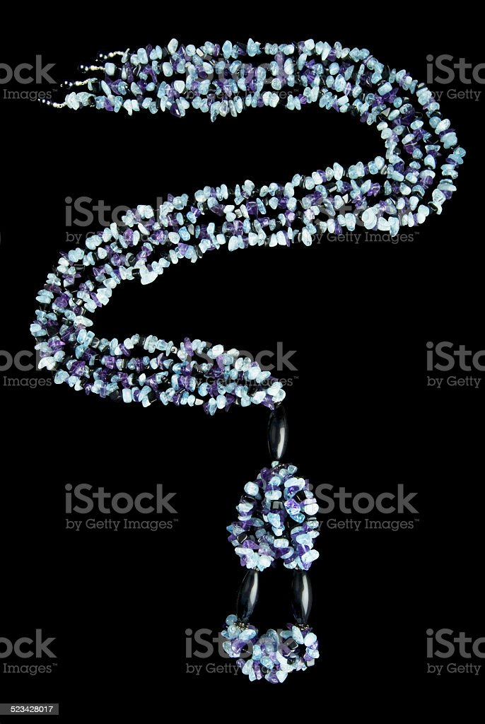 Necklace with Purple, Blue,  and Black Stones stock photo