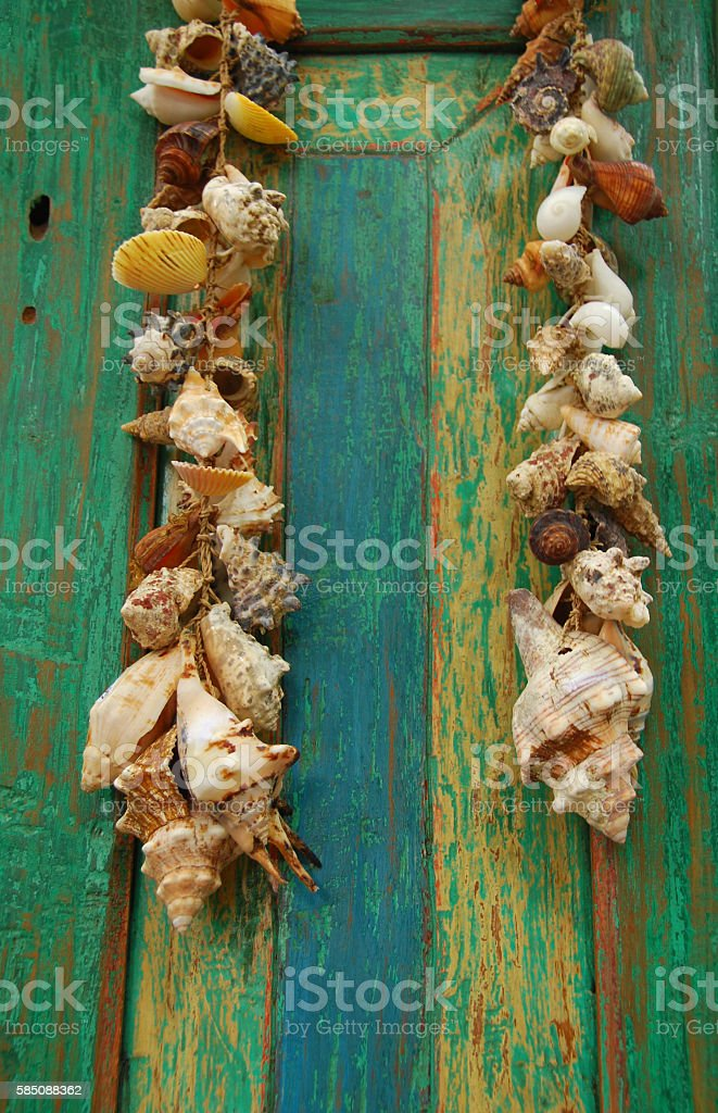 Necklace with sea shells hanging on a colourful  Panel stock photo