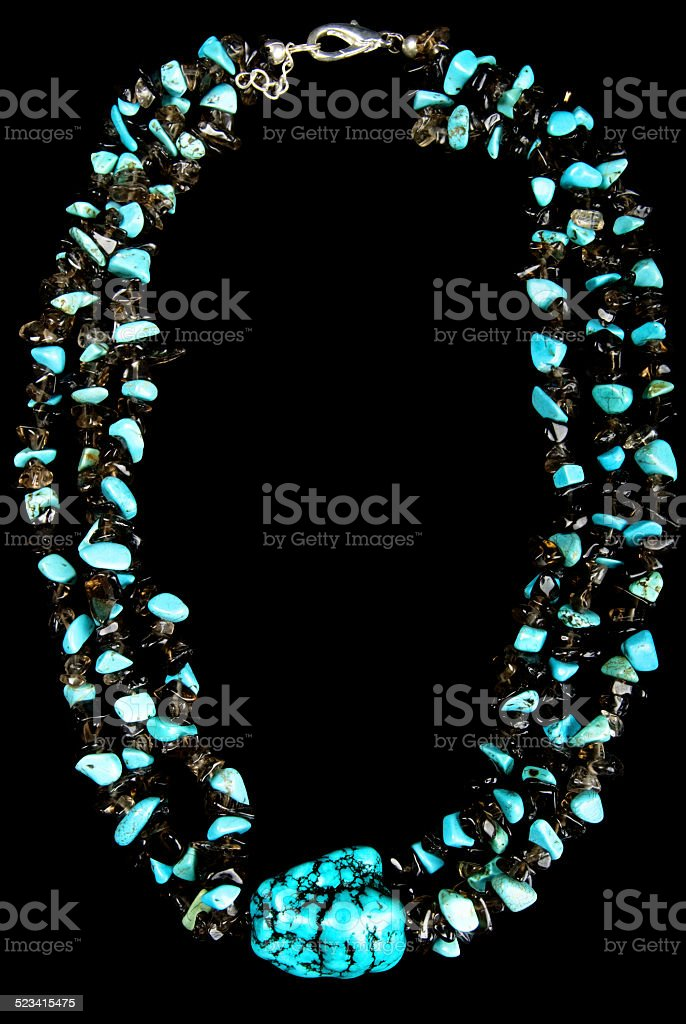 Necklace with Turquoise and Black Stones stock photo