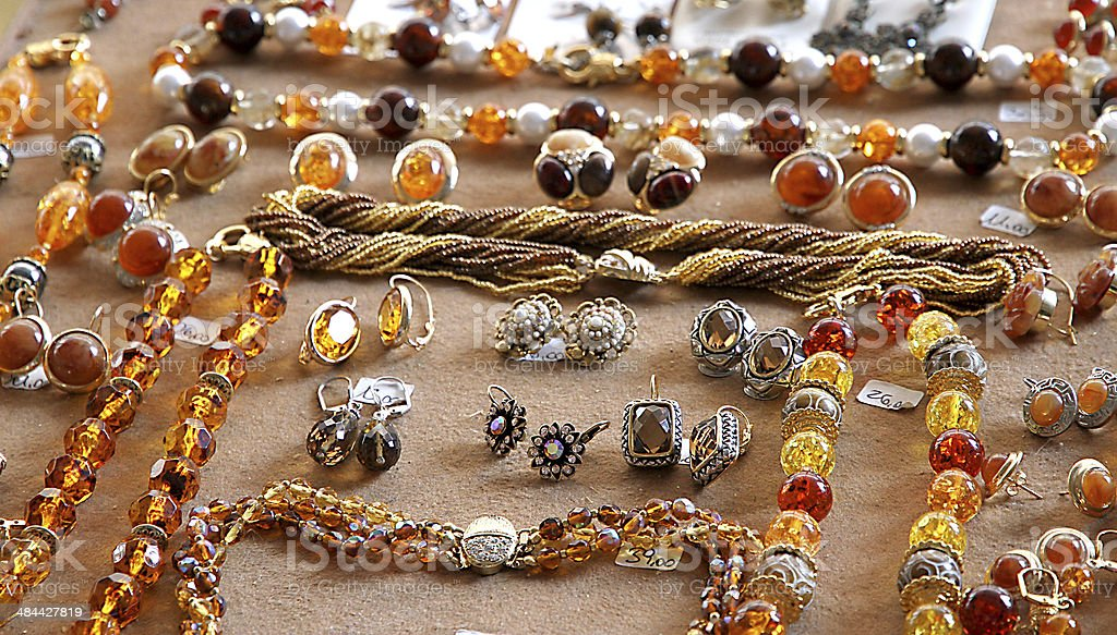 necklaces, earrings, and precious gems made with precious amber stock photo