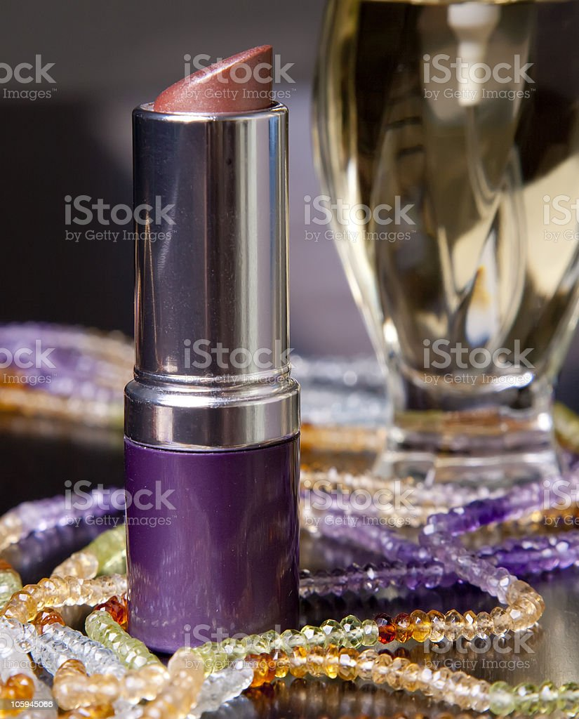 necklaces, lipstick and perfume royalty-free stock photo