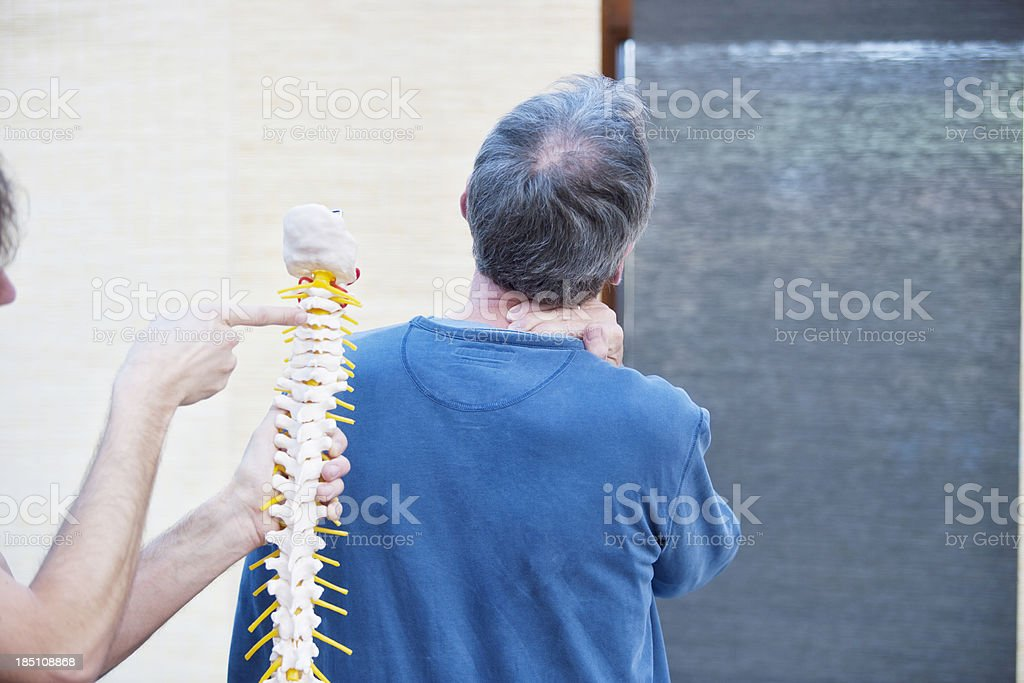 Neck-related pain stock photo