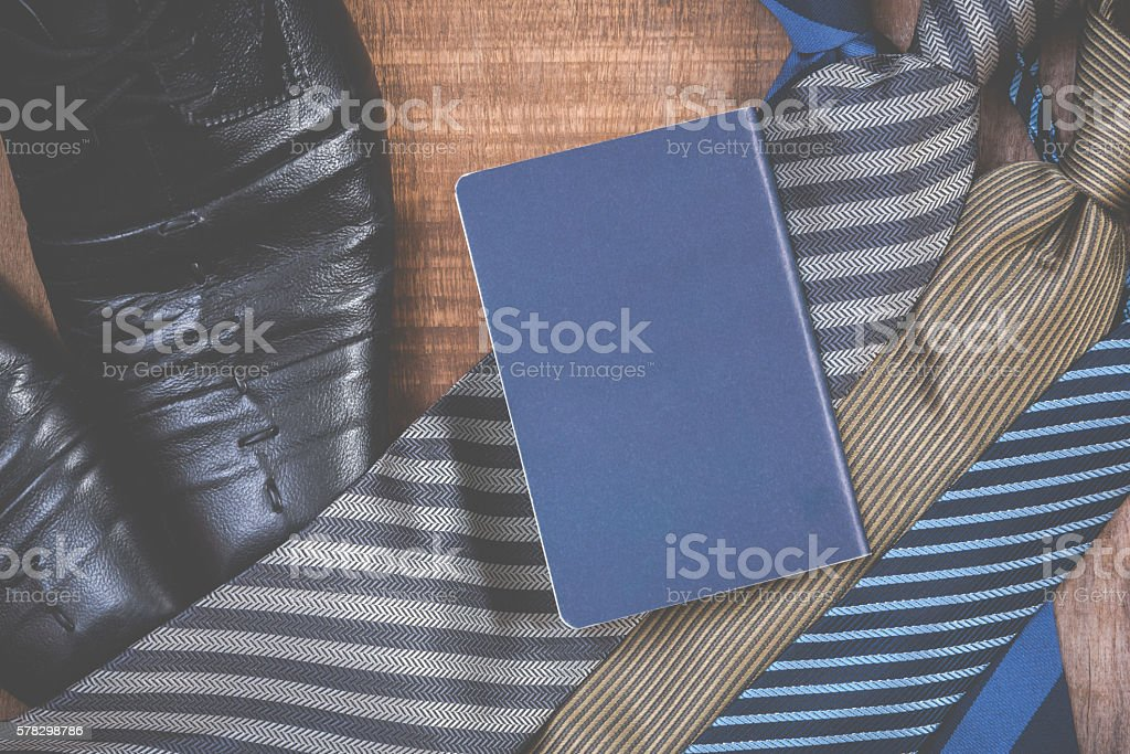 Necktie and shoes,passport on grunge wood background stock photo