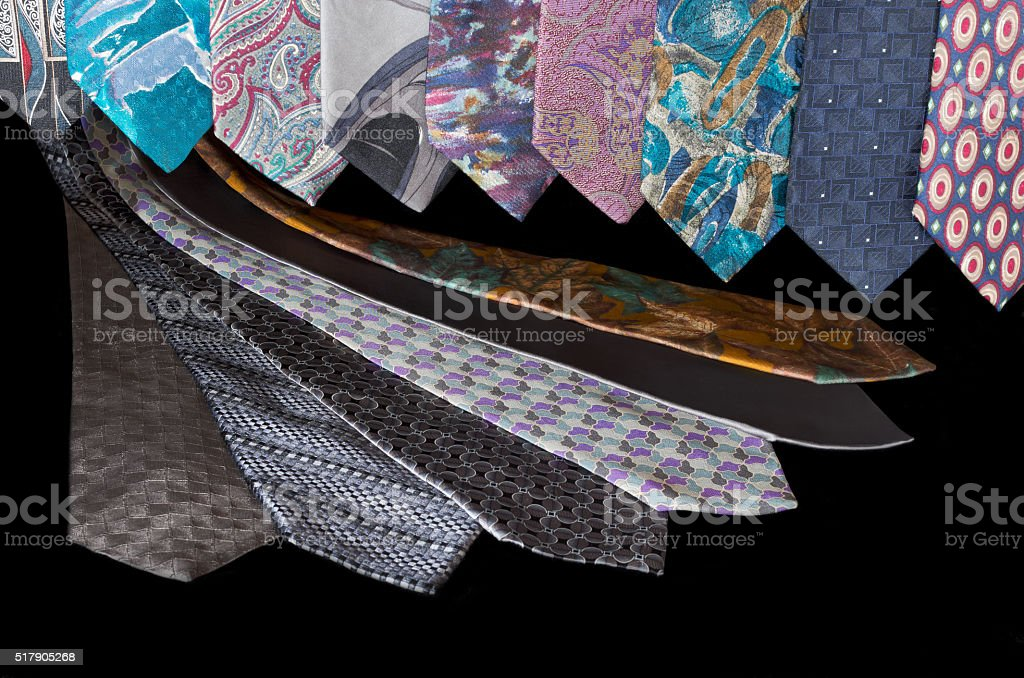 Neckties Hanging and Flat Against Black stock photo