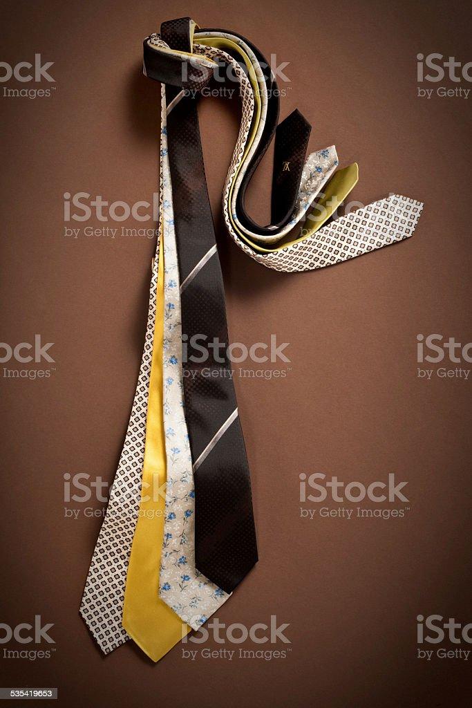 Neckties on  brown background stock photo