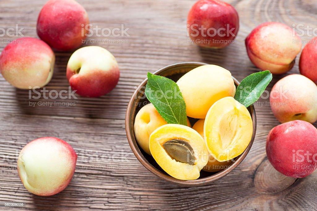 Nectarines, Peach and apricots on wooden table stock photo