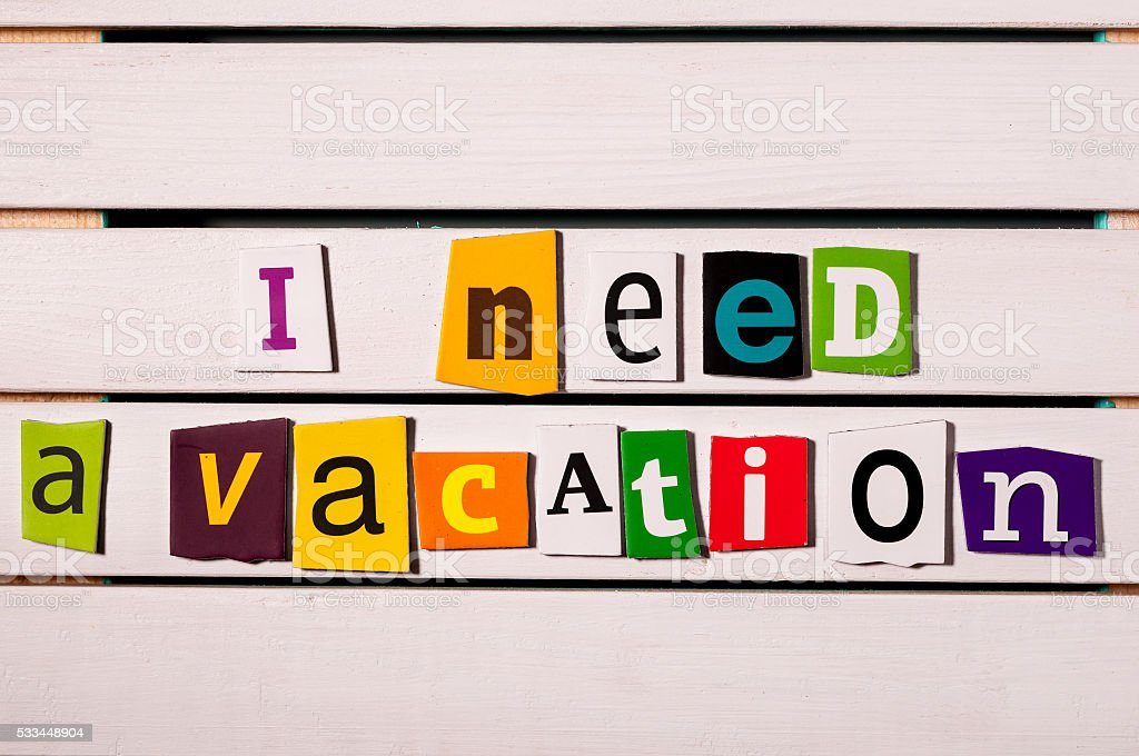 I need a vacation - written with color magazine letter stock photo