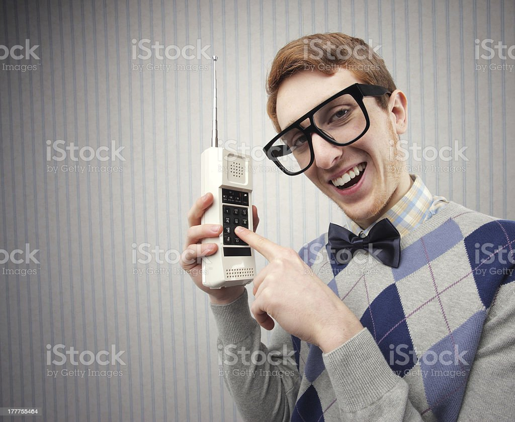 Need student with an old mobile phone stock photo