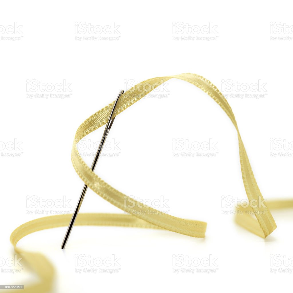 Needle and Golden Ribbon Rope royalty-free stock photo