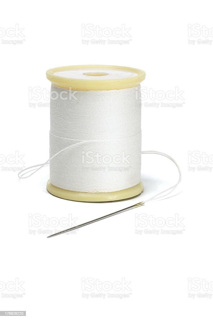 Needle and spool of thread stock photo