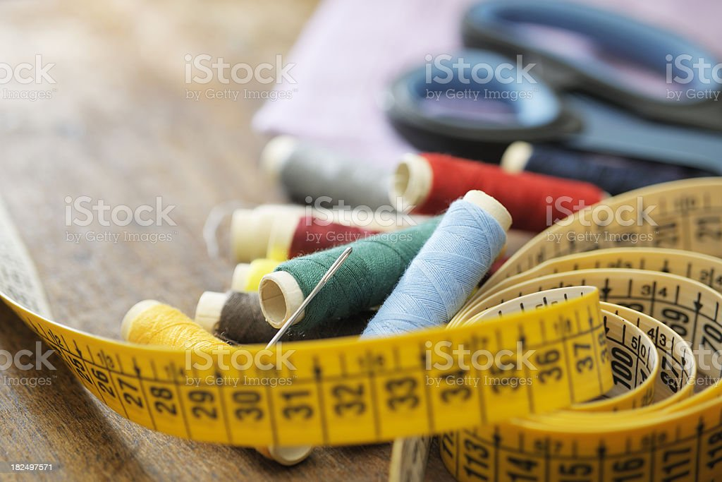 Needle and Thread on Bobbins with Tape Measure plus Scissors royalty-free stock photo