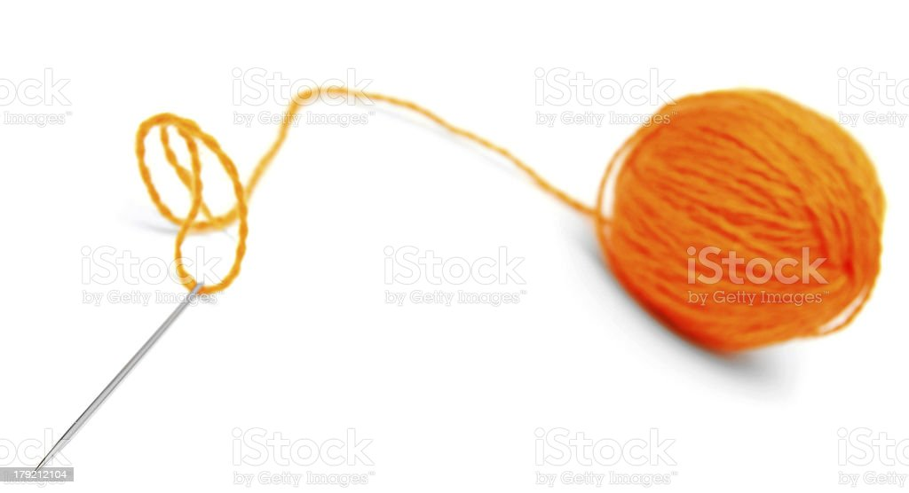 Needle and wool ball. On a white background. royalty-free stock photo