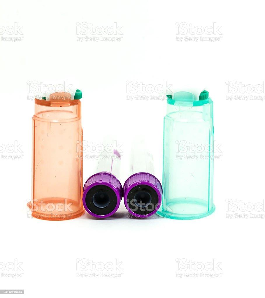 Needle holder and EDTA tube isolate on white background. stock photo