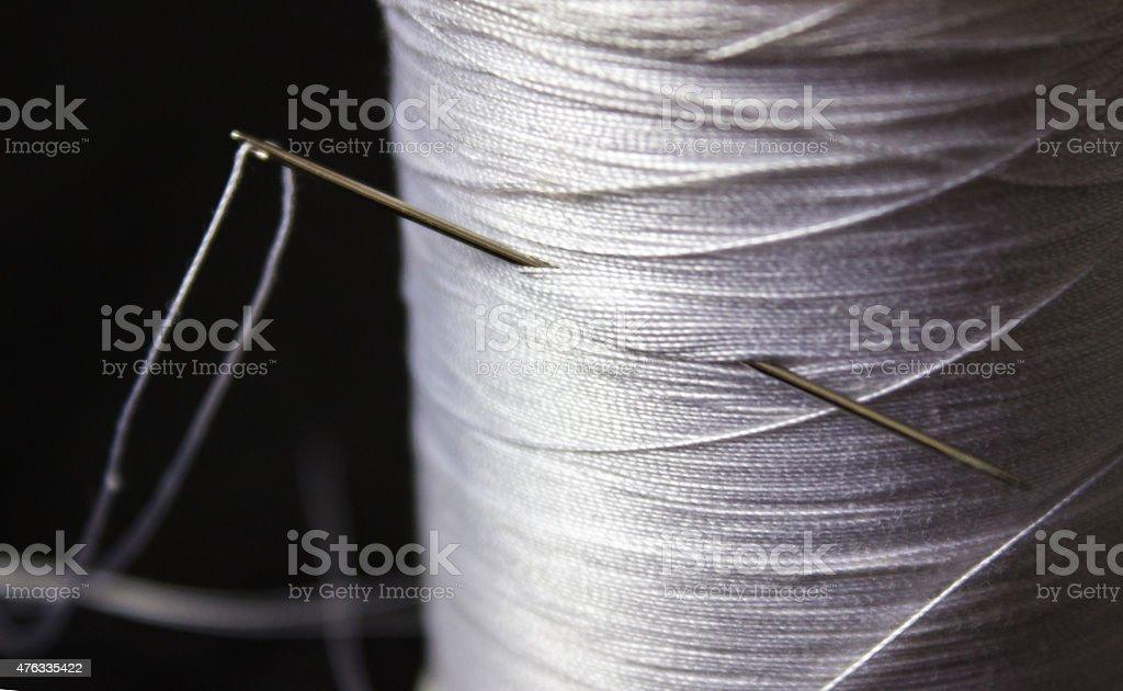 Needle in the spool stock photo