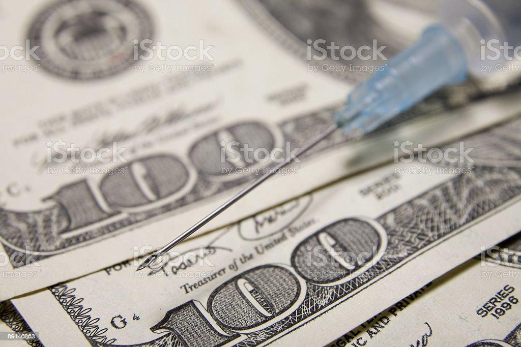 needle over US dollars stock photo