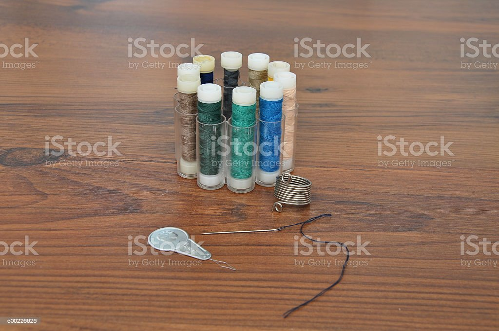 Needle, thread and threader stock photo