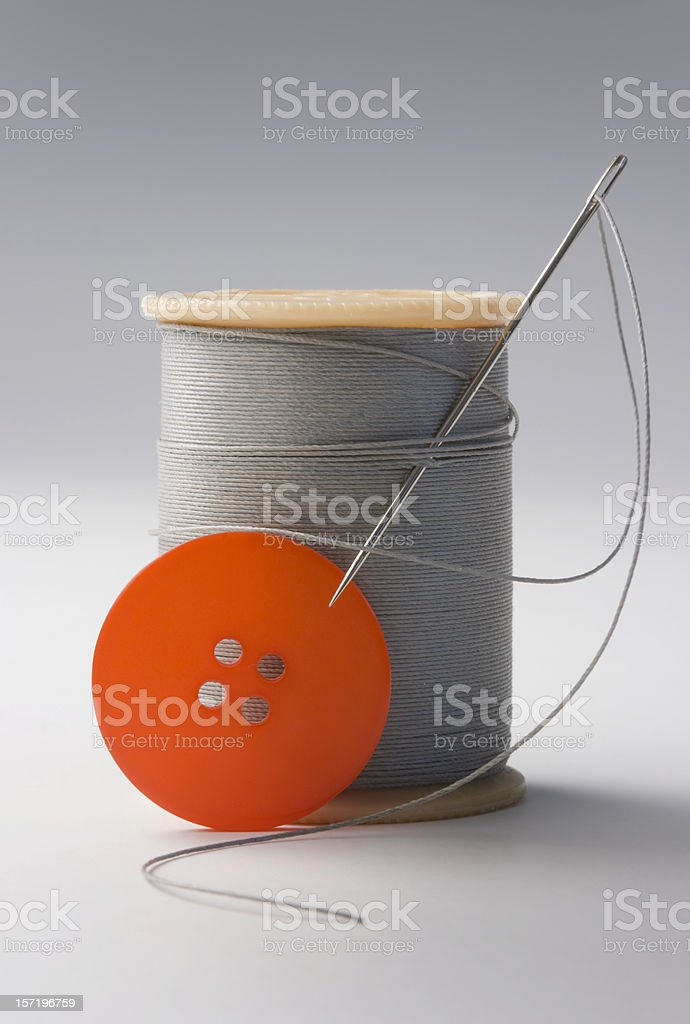 Needle, Thread & Red Button royalty-free stock photo
