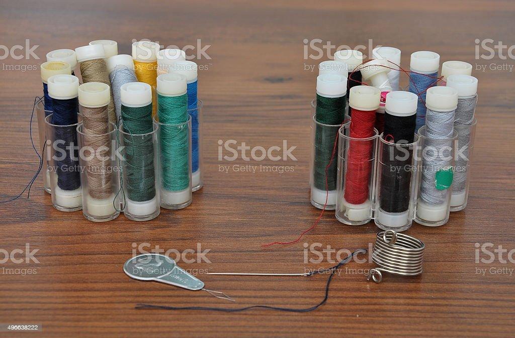 Needle, thread, twine and threader stock photo