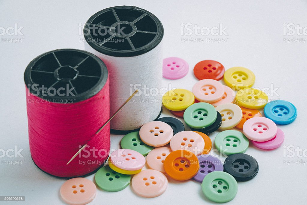 needle with thread,Spool of thread and buttons stock photo