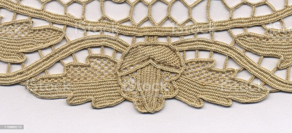 needlelace doily with acorn and oak leaf up close royalty-free stock photo