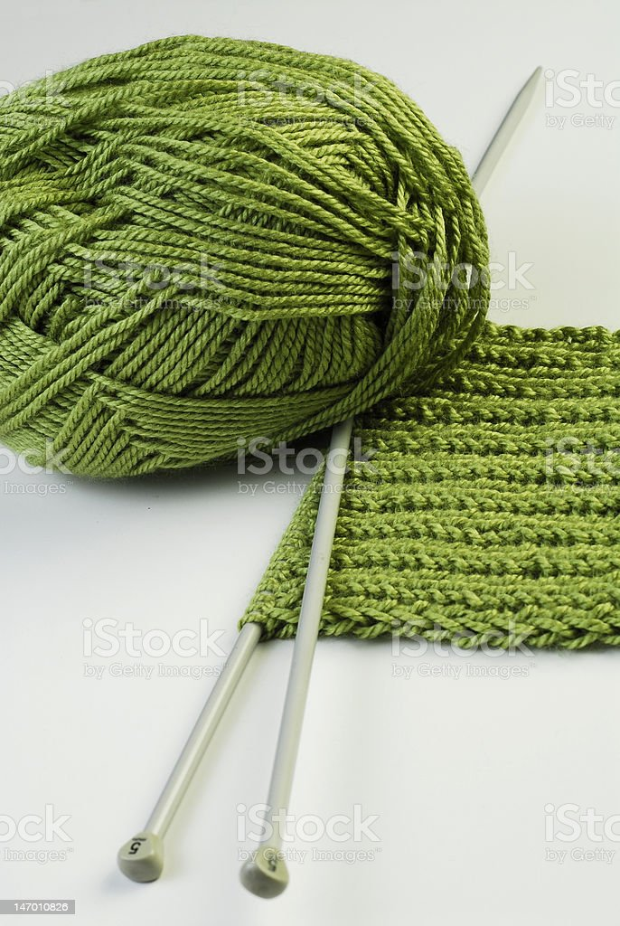 Needles and green yarn royalty-free stock photo