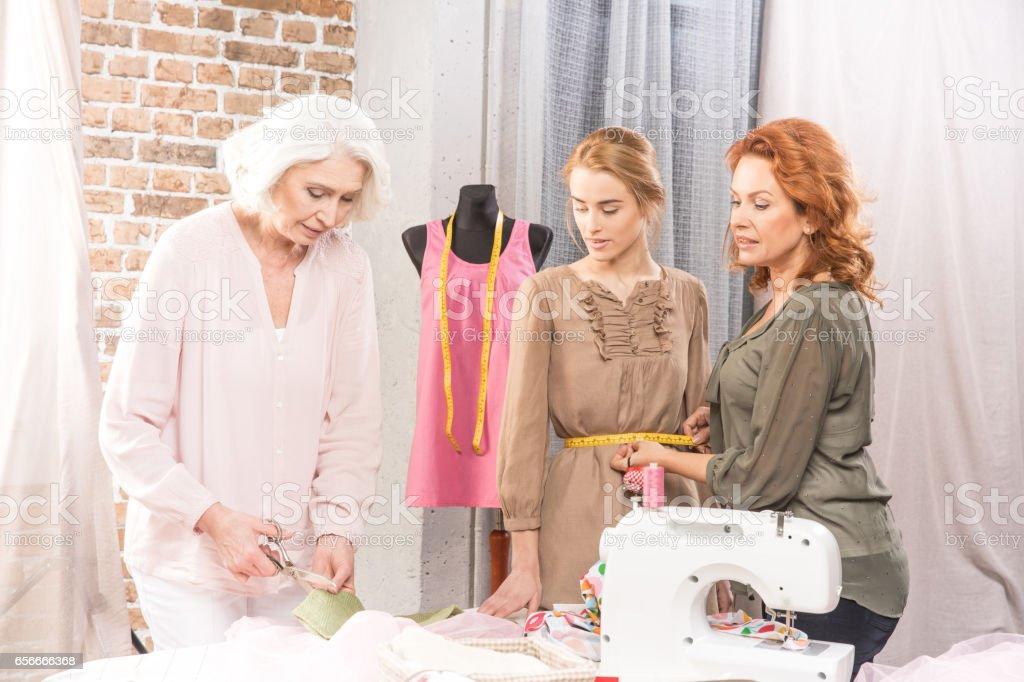 Needlewomen in sewing workshop stock photo
