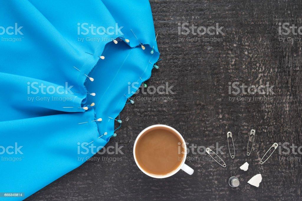 Needlework and coffee on black background stock photo
