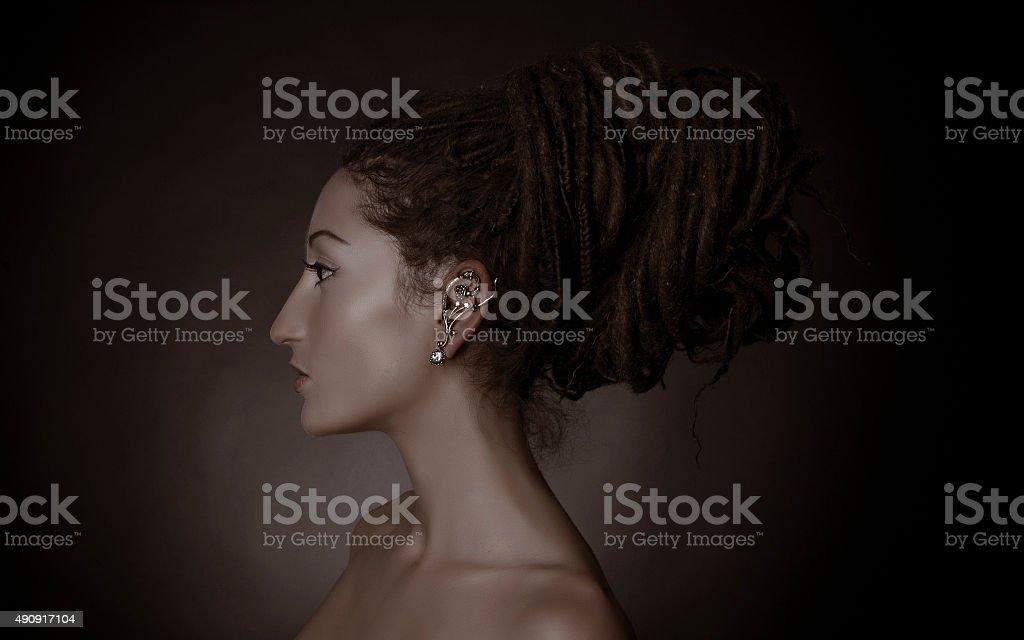 Nefertiti, stylized fashion shoot. Woman with a dreadlocks bun hairstyle stock photo
