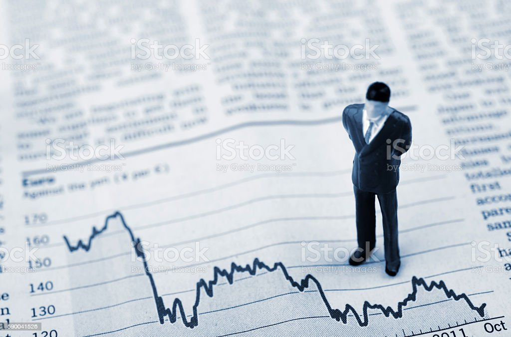 Negative business chart with a businessman stock photo