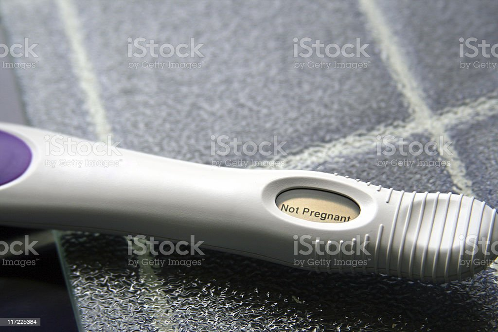 Negative Pregnancy Test on Tiled Kitchen Counter stock photo