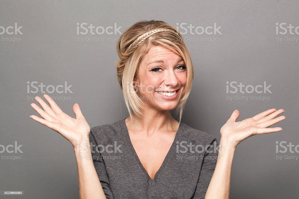 negligence concept for thrilled young blond woman stock photo