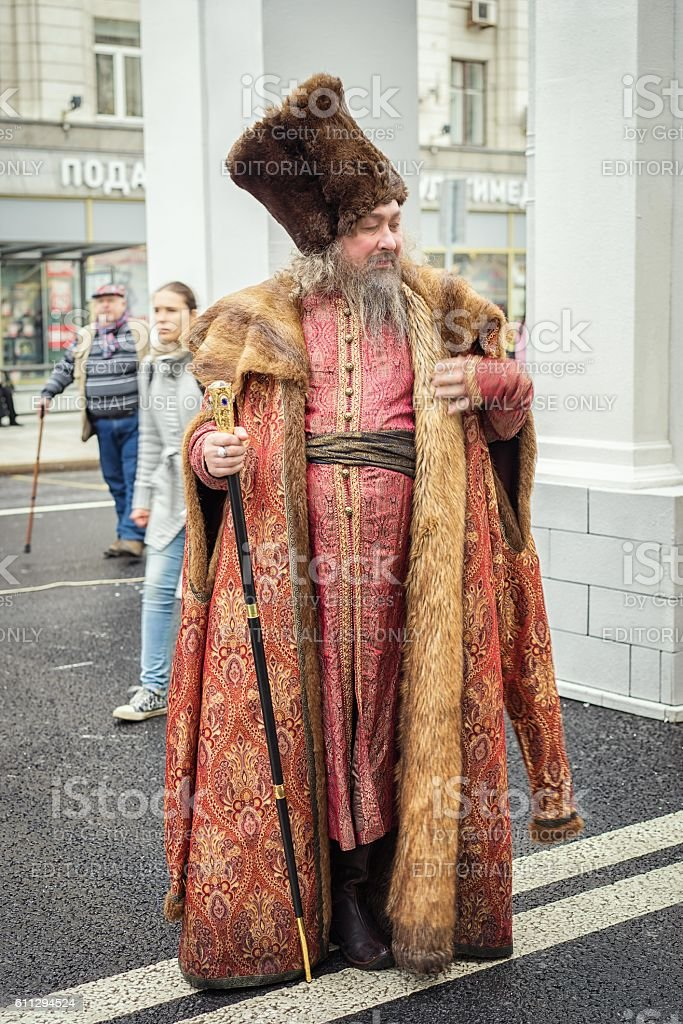 Negotiant in an ancient suit and hat. stock photo