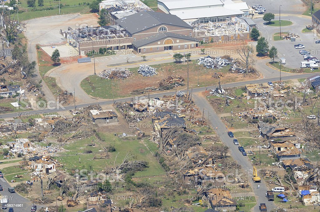Neighborhood and school damaged by tornado royalty-free stock photo