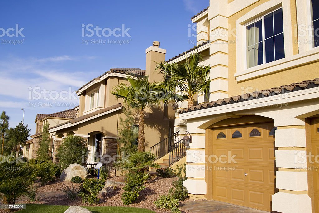 Neighborhood of yellow houses on sunny day stock photo