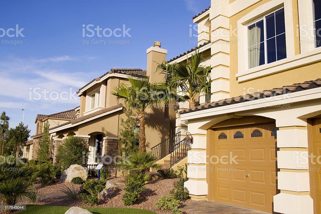 Neighborhood of yellow houses on sunny day stock photo