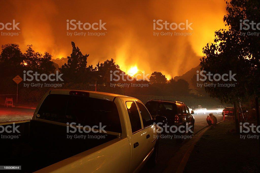 Neighborhood On Fire At Night stock photo