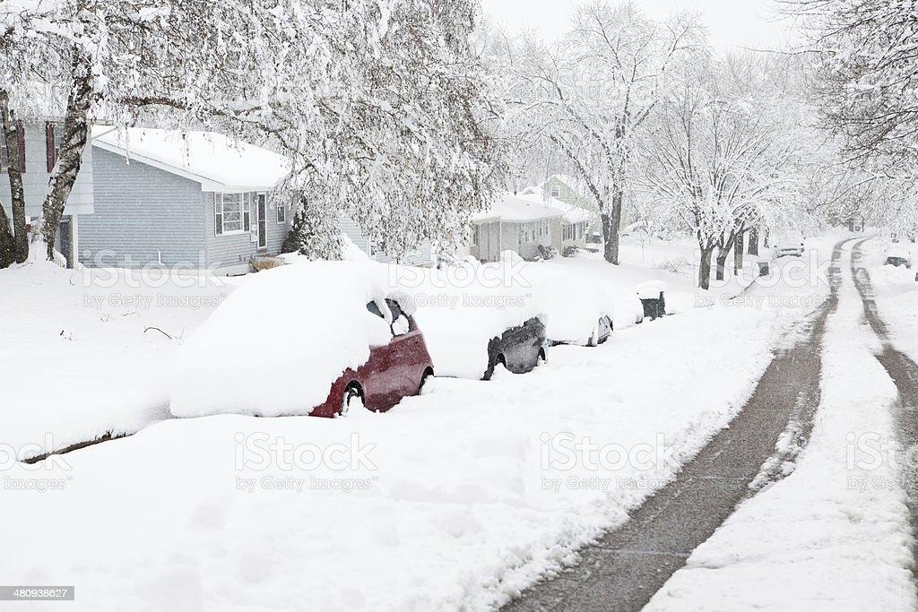 Neighborhood Street During a Major Winter Snowstorm stock photo